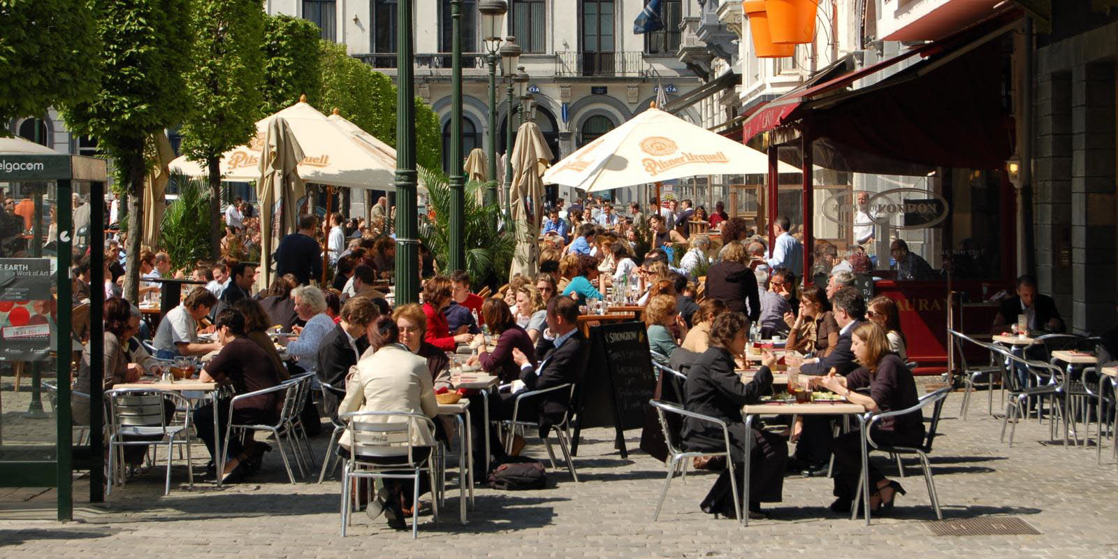 Brussels with outside restaurants and shops in summer weather
