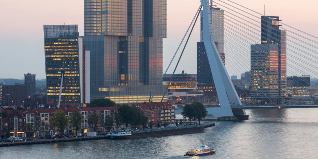 Skyline of Rotterdam with Maas River during sunset