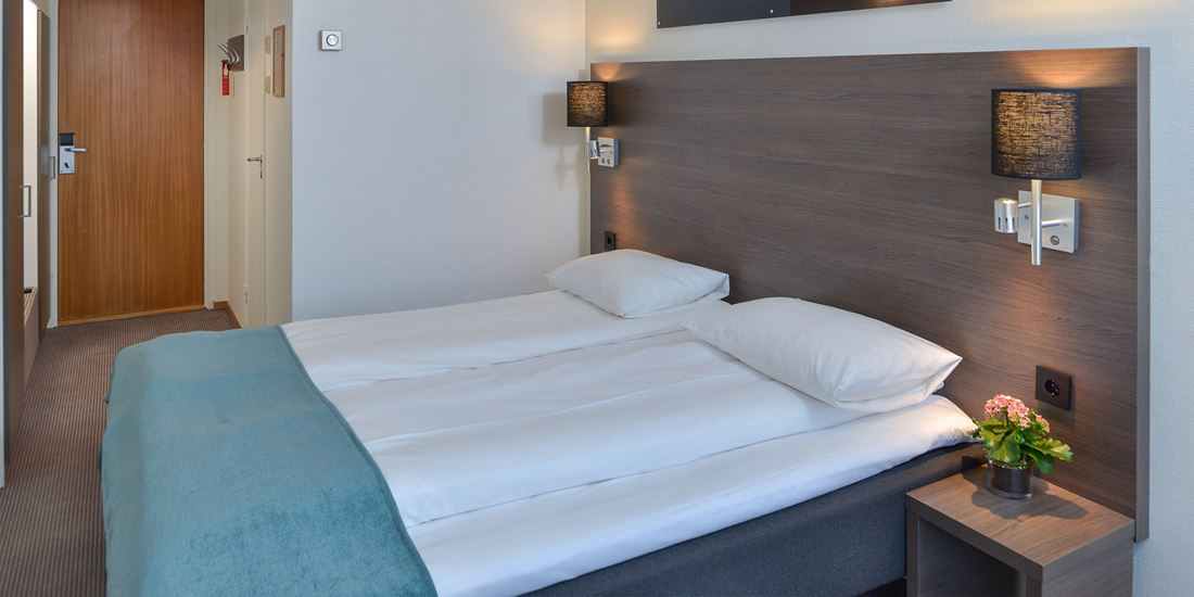 Bed in a Standard Double Room at Thon Hotel Andrikken.