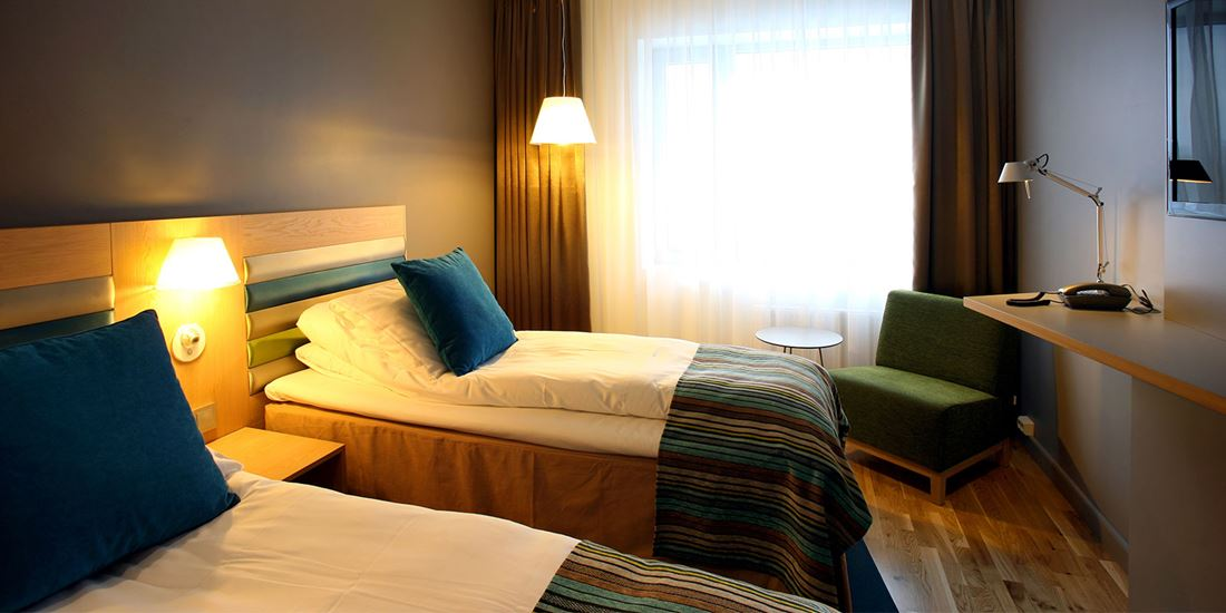 The beds in a Twin room at Thon Hotel Brønnøysund
