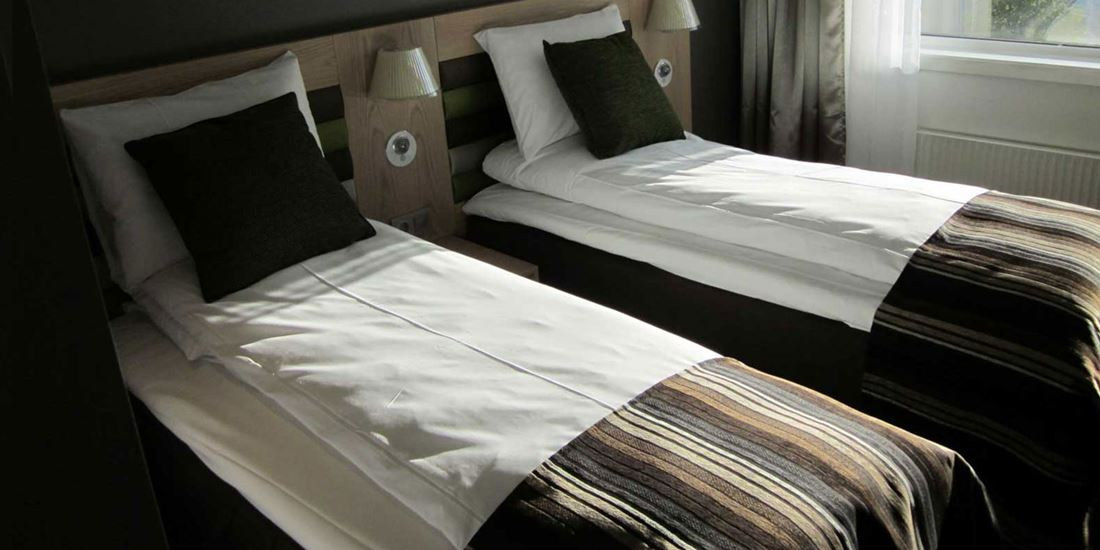 The beds in a Twin room at Thon Hotel Hammerfest