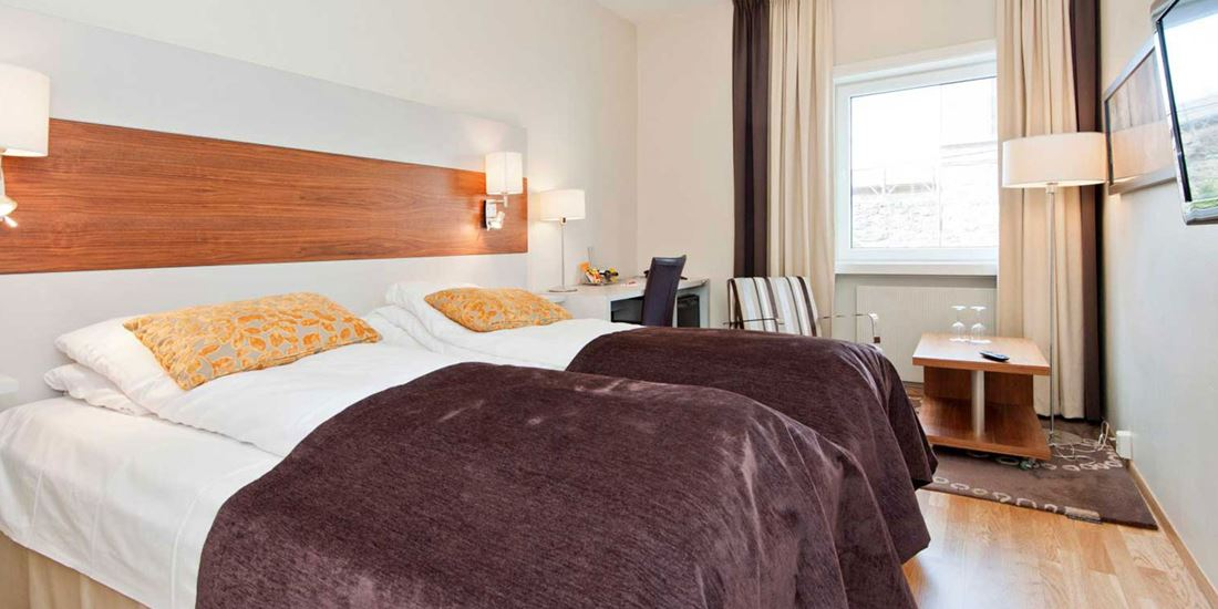 Bed in tweepersoonskamer in Thon Hotel Saga in Haugesund