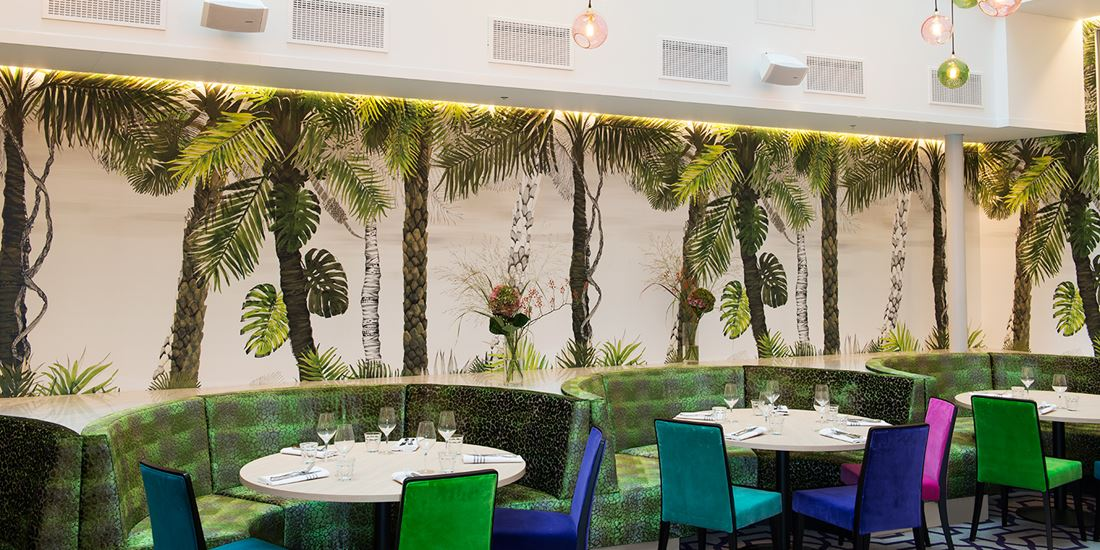 Set tables await diners in the Brasserie Paleo's winter garden