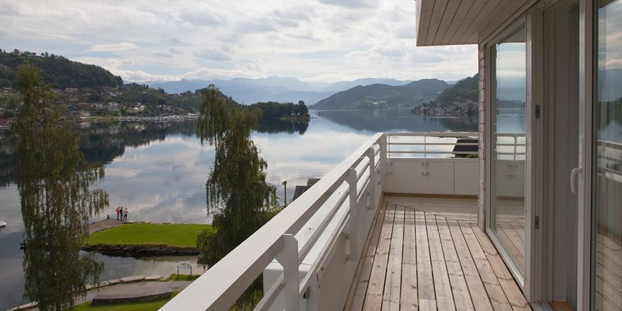The view across the fjord from the terrace of an apartment at Thon Hotel Sandven