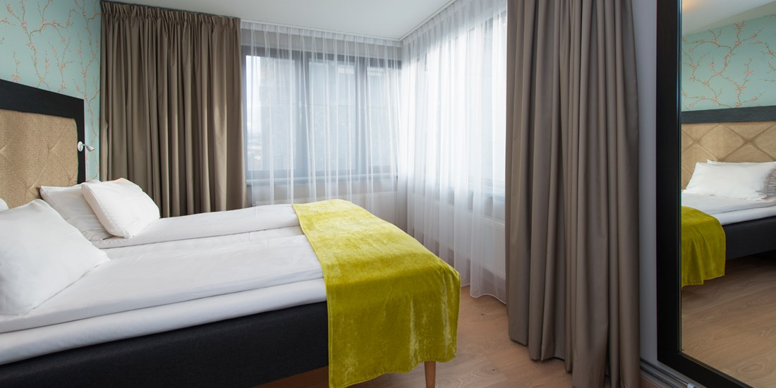 The bedroom in a two-room apartment at Thon Hotel Slottsparken
