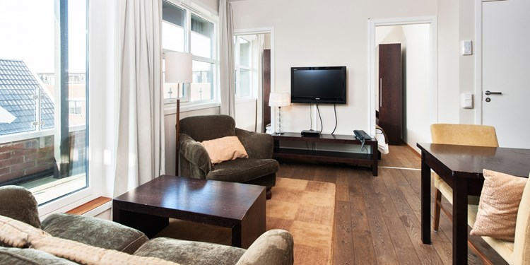 The living room in a two-bedroom apartment at Thon Hotel Sandnes