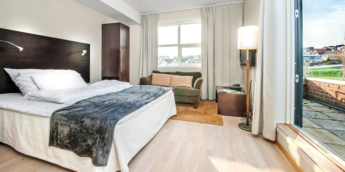 A bedroom in an apartment with two bedrooms, Sandnes Apartments