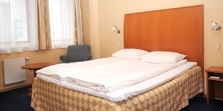 The bed in a 2-bedroom apartment at Thon Hotel Maritim Apartments