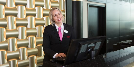 A receptionist at Thon Hotel Opera