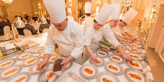 Chefs preparing culinary delights in the kitchen of a Thon hotel