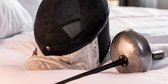 Fencing equipment on a hotel bed
